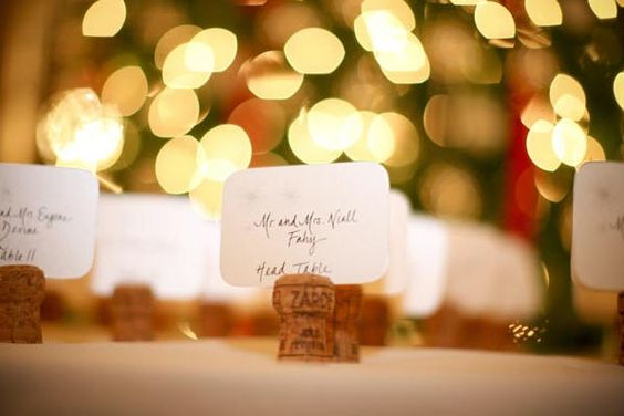 Champagne cork placecards....Maybe not for placecards, but to hold other things, like photos, or signs to label food, where to pick up programs, to remind guests to turn off phones, etc