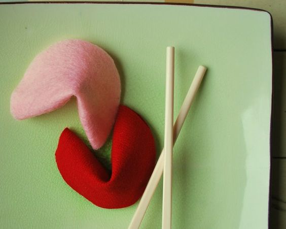 Felt fortune cookies, with your own hand-written fortunes tucked inside, add a personal touch to a romantic meal.