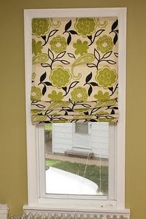 make a roman shade using inexpensive mini-blinds, a little glue and a great piece of fabric