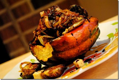 Stuffed Acorn Squash. Balsamic reduction, roasted Brussels sprouts and caramelized onions.