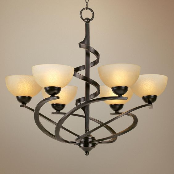 Franklin Iron Works ribbon frame chandelier. Dark mocha finish and 6 lights  with amber glass.