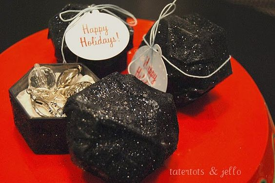 Coal gift boxes.  I love cute ways to wrap gifts.  Now to get ambitious and make some of these.  So creative and it is sparkly.