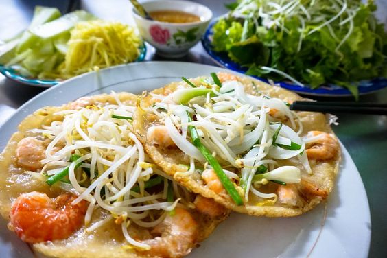 Featuring fresh herbs, succulent seafood, and a special flour mix called banh xeo, these Vietnamese pancakes are crispy, savory and delicious.
