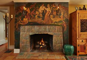 This magnificent fireplace features tiles around the firebox of Mayan ...