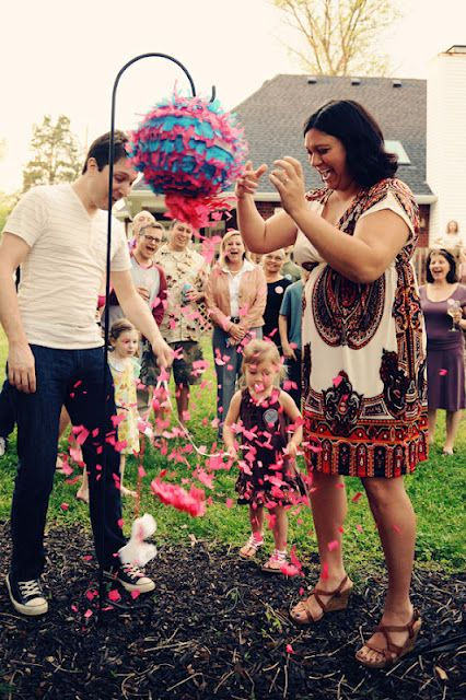pink and blue baby gender reveal pinata with pink or blue confetti, candy, and trinkets inside depending on the sex of your baby - great to do if you already have a child and makes the idea of a new sibling fun.