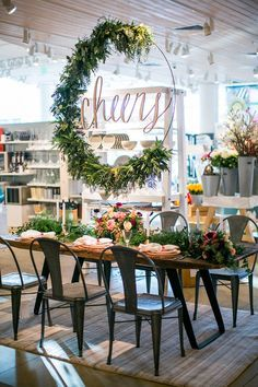 beautiful tablescape, hanging flowers, idea, cheers, mix industrial and wood, retail shop