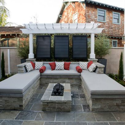 great backyard patio set-up, little fire place with benches.