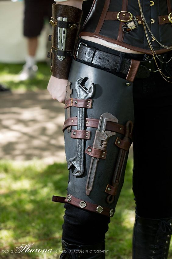 Utilitarian Belt. Wraps around leg, harnessed at bottom and looped onto belt. Has several holster slots for tools   Note gauntlet with slot to hold butterfly knife. =) (not a utilitarian knife, but good idea)