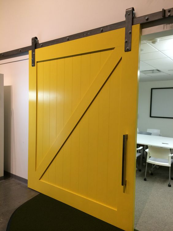 Google office barn door big yellow modern level three d for Oversized barn doors