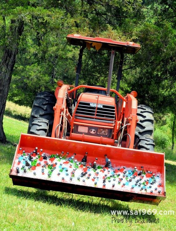Front loader used to ice down drinks for wedding guests / http://www.deerpearlflowers.com/wedding-drink-bar-station-ideas/2/