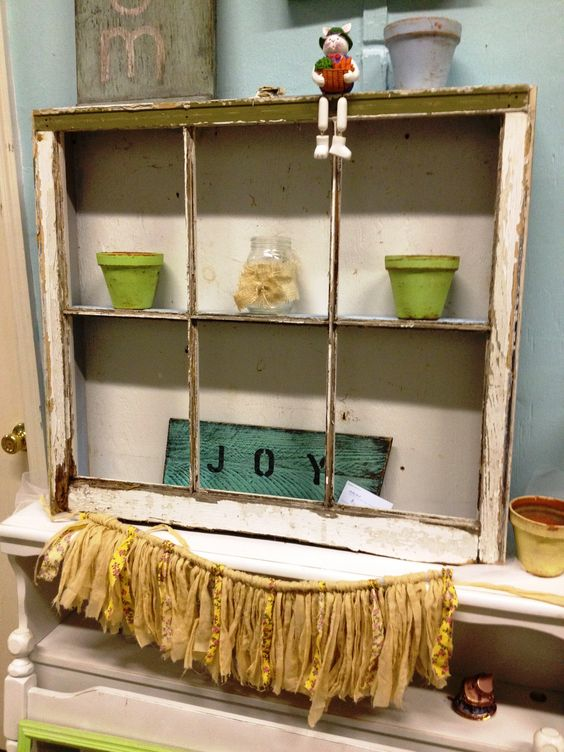 an old window made into a shadow box
