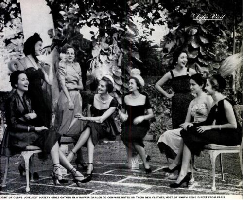 """Eight of Cuba's loveliest society girls gather in a Havana garden to compare notes on their new clothes, most of which come direct from Paris"" From LIFE Magazine - Feb 6, 1950"