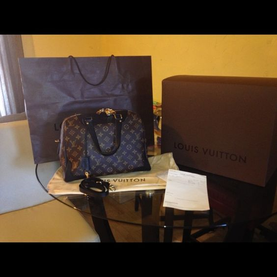 Louis Vuitton Retiro Noir NM Authentic Louis Vuitton Retiro Noir NM comes with box, dust bag, shoulder strap, receipt and shopping bag. The date code is SP2185. This bag cost $2,110.00 not including tax. It's been used but not abuse. I bought it this Year. If you want to but for cheaper I would be glad to do ️️for 1,800.00 or best offer or I can do layway in till you finish paying for it. Louis Vuitton Bags Satchels