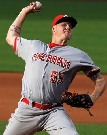 Reds starting pitcher Mat Latos pitches in the first inning.