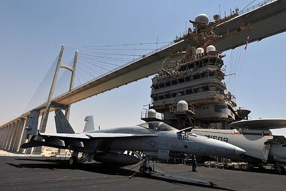 The Nimitz-class aircraft carrier USS Abraham Lincoln passes underneath the Friendship Bridge as the ship transits the Suez Canal.