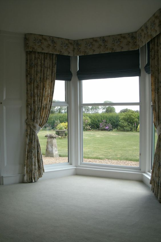 Hard Pelmet Curtains And Roman Blinds In Bay Window