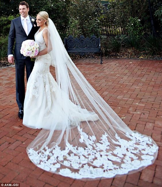 It's a nice day for a white wedding: The bride wore a lace white fishtail gown with a dramatic veil