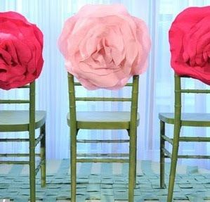 Gorgeous huge  #fabric #flowers adorn the backs of these #chairs
