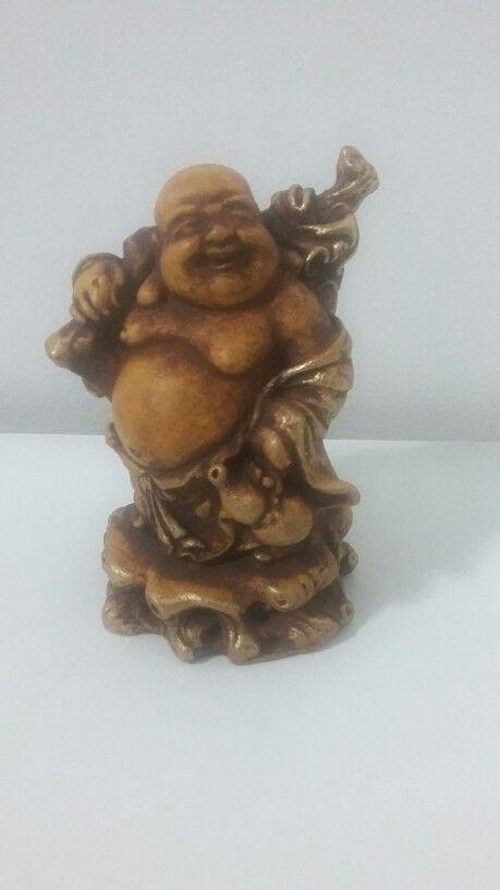 Estátua  Buda sorrindo.