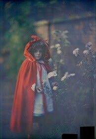Joan in Red Riding Hood cape with basket. 1907.