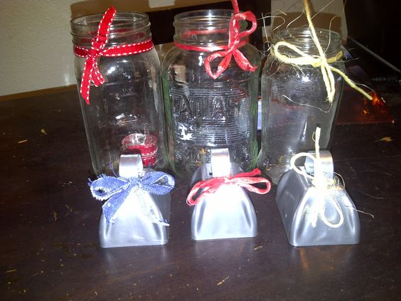 Used mason jars, with ribbon wrapped around them, used as center pieces at the wedding. We filled them with Daises the morning of the wedding. Cowbells bought in bulk online, with ribbon tied in a bow. When the rang the bell, the bride and groom (We) kissed.