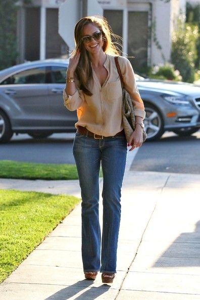 Tan blouse + jeans + bracelets. Minka Kelly.: