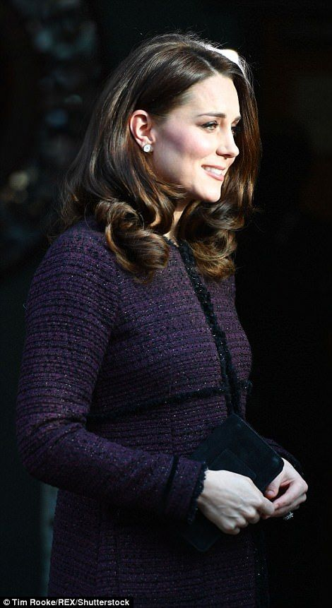 The Duchess looked elegant in a recycled purple coat from maternity brand Seraphine...
