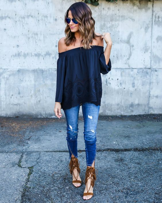 off the shoulder, navy top, distressed jeans and brown suede fringe heels: