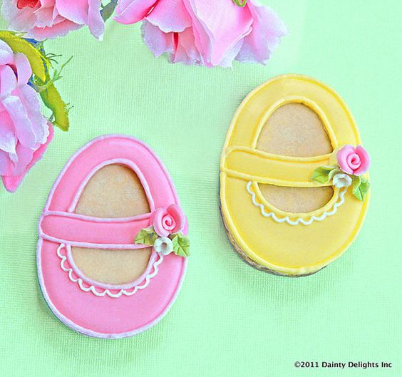 baby shoes. LOOKS LIKE THEY ARE MADE WITH AN EGG SHAPED COOKIE CUTTER. KC