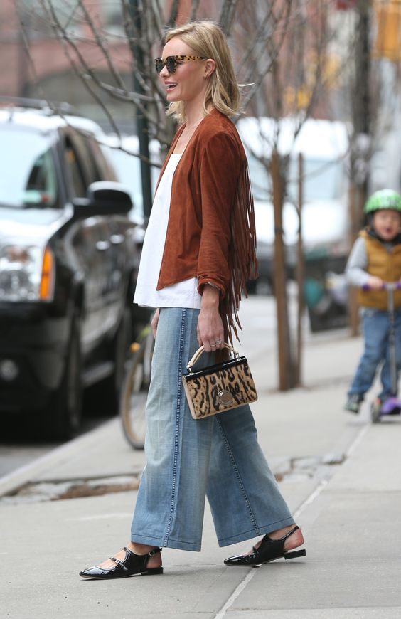 The proportions are so good. - Suede tassels, wide-leg denim and patent mules. Kate Bosworth, we ain't worthy.