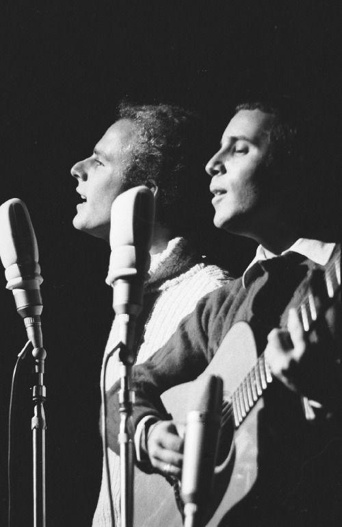 Simon & Garfunkel - The Sound of Silence - http://www.youtube.com/watch?v=dTCNwgzM2rQ