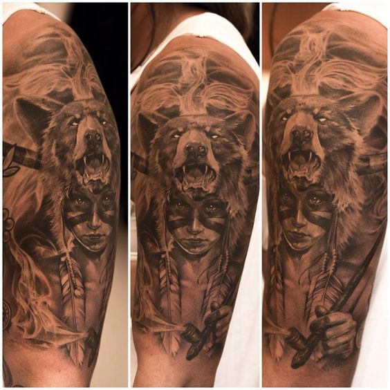 Arm sleeve tattoo. Girl in native face paint wearing a bear headdress and holding a pipe.