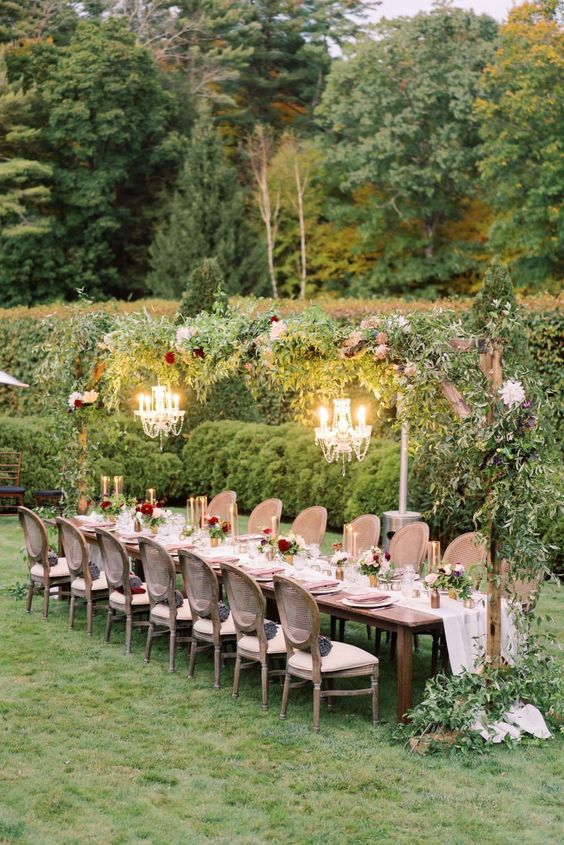We just love garden weddings and this beaut at The Mount in Massachusetts is to die for! With a canopy of jewel toned florals and greenery over a long table with mauve napkins and cozy blankets set in each chair, we are officially in LOVE. #ruffledblog