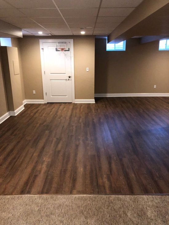 The Look Of The Coretec Luxury Vinyl Tile Next To The Soft And Luxurious Carpet Is Perfect The Transition From C Diy Interior Doors Luxury Vinyl Tile Flooring