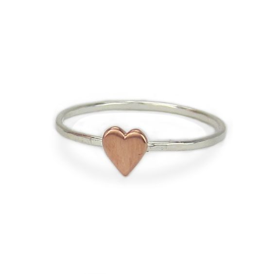 Tiny Copper Heart and Hammered Sterling Silver Heart Ring. $13.00, via Etsy.