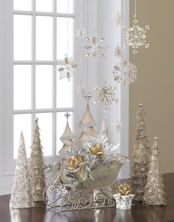 Crystal snowflakes and silver and gold Christmas trees and sleigh: