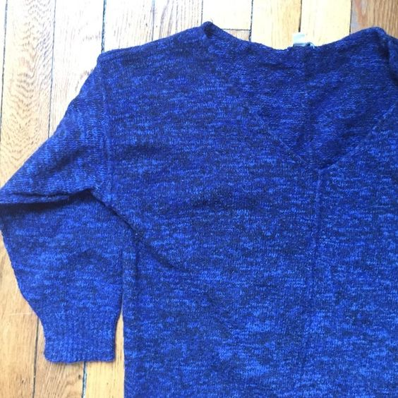 3/4 sleeve sweater Size medium on tag, but fits like a small (listed here as small). Acrylic, wool, cotton, & polyester Sweaters V-Necks