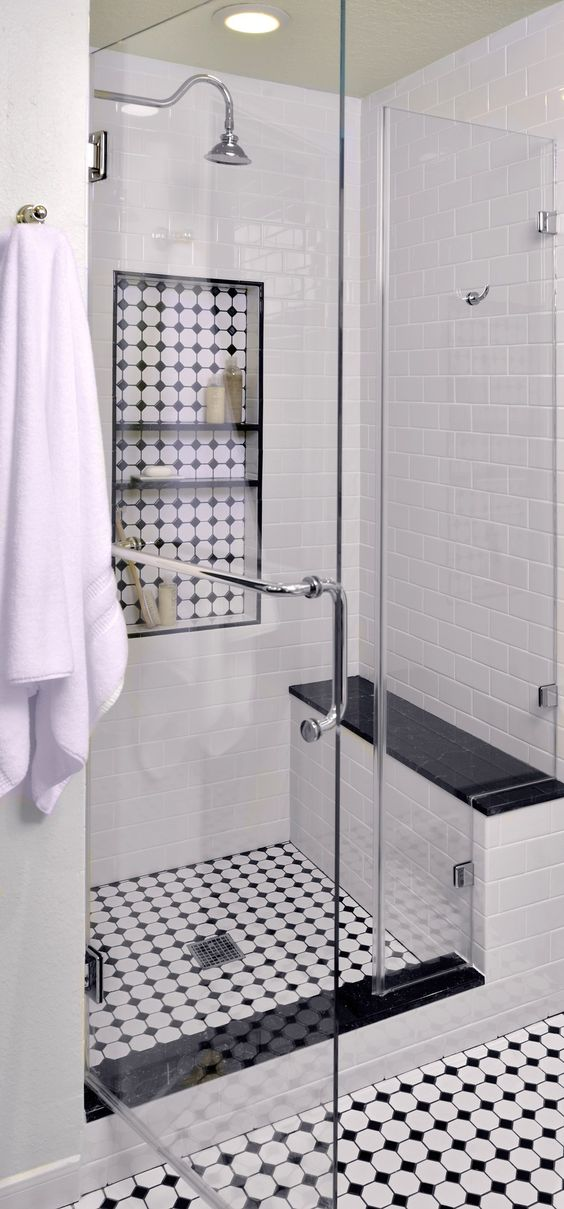 Vintage-inspired master bathroom  Interior Designer: Carla Aston. Tile makes a big impact in this re-model - black and white tile, shampoo niche, black marble, mosaic tile shower
