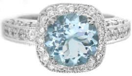 """Aquamarine comes from the Latin word for """"sea water"""" and was said to be a gift to the mermaids from Neptune, the King of the Sea. 2.55 ctw Round Aquamarine and Diamond Ring."""
