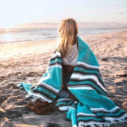 This fish-design yoga blanket is a thick, traditional style Mexican blanket. Heavier than falsa blankets it makes an excellent throw for your bed or sofa.