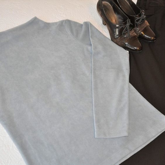 Gorgeous light blue top. Great for work or wig jeans. Long sleeve, mock turtle neck. Banana Republic Tops