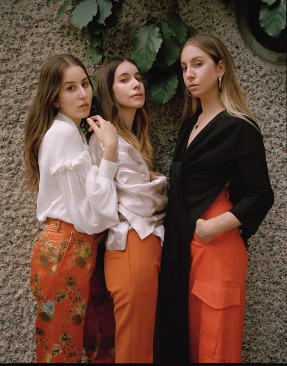 It's a sweltering, appropriately Californian morning in London and, within the air-conditioned sanctuary of Fitzrovia's Villandry restaurant, the Haim sisters are explaining their father's unique approach to limiting their screen time as children. 'He was a drummer, so he set up a drum kit right in our living room and would just play,' explains Danielle, the band's lead vocalist and guitarist. 'So it was just impossible to watch TV.' 'I think that's how he got us to not watch it,' chips in ba...