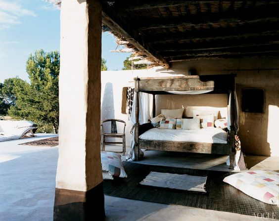 Marni head designer Consuelo Castiglioni placed a Balinese daybed under the eaves of her Formentara, Spain vacation home. The daybed is outfitted with linens by the label.: