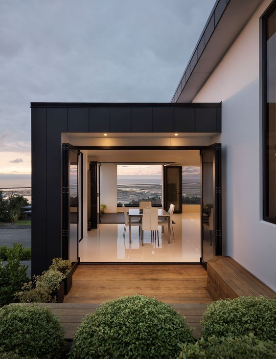 black-clad home with view