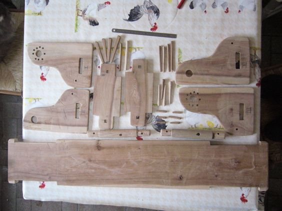"""Reproduction medieval loom parts. Unfortunately there's no image showing how this fits together, only a detail. Suspect it's similar to the one depicted in """"le travail de la laine""""."""