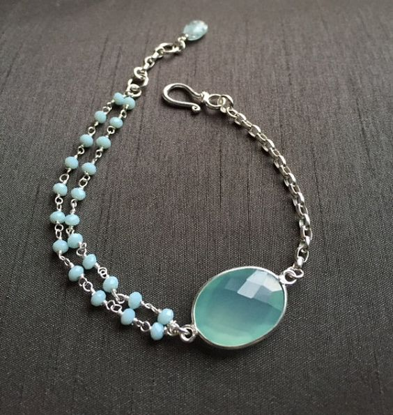 """Aqua Blue Chalcedony Bracelet  by BitsofSilver; the perfect go to accessory for spring! This bracelet is handmade pairing Chalcedony rosary chain to a sterling silver rope chain for the look of modern simple styling.Extended links has been added to provide the maximum length of 73/4,"""" minimum 7"""". Only one available.($45)"""