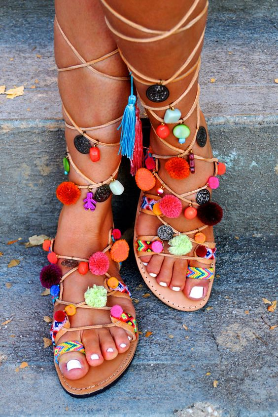 Tie Up Gladiator sandals Misty decorated with orange Corals, friendships, multicoloured Pom Pom & beads. The absolutely perfect pair of sandals for: