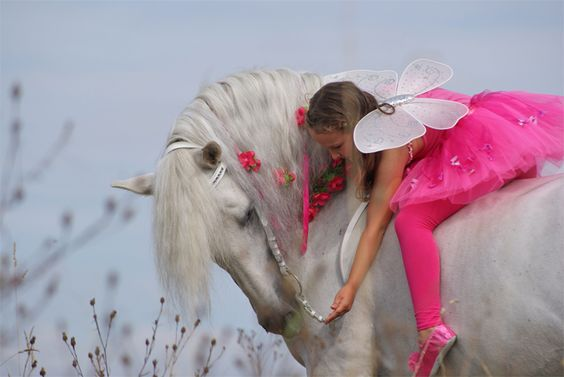 Lisa and Ponent Fairy Lisa and PRE stallion Ponent  little girl and white horse