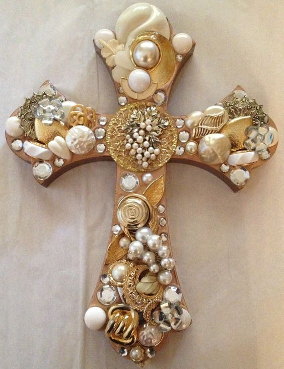Stunning cross adorned with white, cream, goldtone and silvertone vintage jewelry, beads and rhinestones. A beautiful pearl brooch is