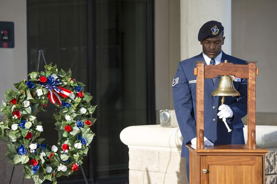 Staff Sgt. Xavier Henderson, 45th Security Forces Squadron NCO in charge of supply, rings a bell during the Fallen Heroes Ceremony at Patrick Air Force Base, Fla. May 13, 2014. Henderson rang the bell once for each fallen defender and then one final ring for all who lost their life in the line of duty. The ceremony took place as part of National Police Week May 12-16. (U.S. Air Force photo/Matthew Jurgens